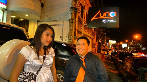 Two party peeps outside Luna Bar & Resto